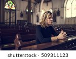 woman sitting church religion... | Shutterstock . vector #509311123