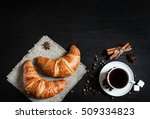 Coffee And Croissants On Blac...