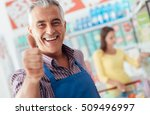 happy supermarket clerk smiling ... | Shutterstock . vector #509496997