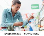 woman checking the grocery... | Shutterstock . vector #509497057