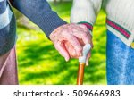Elder Couple With Stick Hand T...