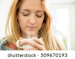 woman holding cup of hot coffee ...   Shutterstock . vector #509670193