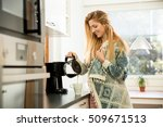attractive woman in the kitchen ... | Shutterstock . vector #509671513