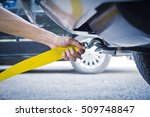 hand holding yellow car towing... | Shutterstock . vector #509748847