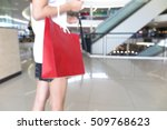 woman with shopping bag | Shutterstock . vector #509768623
