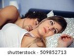 thoughtful woman lying near her ... | Shutterstock . vector #509852713