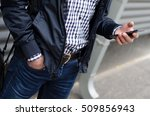 young man using his phone on... | Shutterstock . vector #509856943