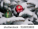 christmas toys on a snow... | Shutterstock . vector #510053803