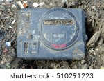 Small photo of BANGKOK, THAILAND - NOVEMBER 05 : Sega Mega Drive be left in mud on November 05, 2016. It is the 16-bit home video game console which was developed and sold by Sega Enterprises, Ltd.