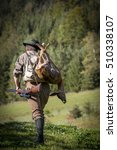 Small photo of successful styrian hunter with slain deer