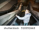 boy on the escalator in the... | Shutterstock . vector #510352663