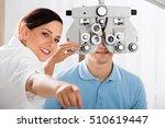 happy female optometrist doing... | Shutterstock . vector #510619447