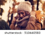 autumn woman on leafs background   Shutterstock . vector #510660583