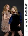 Two Beautiful Girls In Fashion...