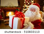 santa claus sitting by the... | Shutterstock . vector #510833113