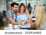 three people having fun in cafe | Shutterstock . vector #510916483