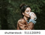 girl with cup of coffee on the... | Shutterstock . vector #511120093