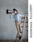 little producer with a megaphone | Shutterstock . vector #511125097