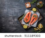 two fresh raw salmon steaks on... | Shutterstock . vector #511189303