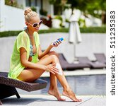 tanned woman applying sun... | Shutterstock . vector #511235383