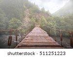 Hanging Wooden Bridge Over...