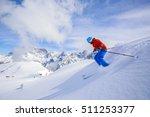 skier skiing downhill in high... | Shutterstock . vector #511253377