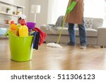 man holding mop and plastic... | Shutterstock . vector #511306123