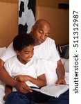 father and son reading. | Shutterstock . vector #511312987