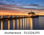 Small photo of Roanoke Marshes screw-pile lighthouse on Shallowbag Bay in Manteo, North Carolina in the Outer Banks at sunrise.