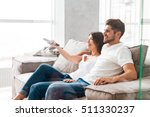 happy young couple sitting and... | Shutterstock . vector #511330237