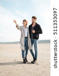 cheerful young casual couple... | Shutterstock . vector #511353097