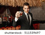 handsome young man in a stylish ... | Shutterstock . vector #511539697