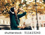 young woman enjoying music via...   Shutterstock . vector #511615243
