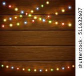 christmas light on wooden... | Shutterstock . vector #511632607