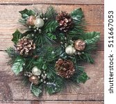 christmas wreath on wooden... | Shutterstock . vector #511667053