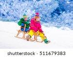 little girl and boy enjoy a... | Shutterstock . vector #511679383