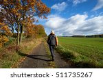 pedestrian on the road between... | Shutterstock . vector #511735267