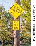 Bicycle Lane Sign On Side Walk...