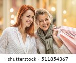 in the city  a mother and her... | Shutterstock . vector #511854367