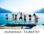 a group of friends jumping off... | Shutterstock . vector #511865767