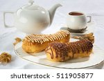 eclairs for a dessert with tea | Shutterstock . vector #511905877