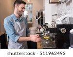 delighted handsome waiter using ... | Shutterstock . vector #511962493