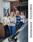 family standing outside their... | Shutterstock . vector #512123803