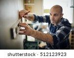 mature man using a spirit level ... | Shutterstock . vector #512123923