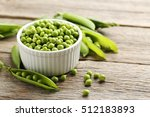 Green Peas On A Grey Wooden...