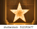 decorative star with lamps on a ... | Shutterstock . vector #512192677