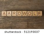 Small photo of aardwolf word on a wooden cubes