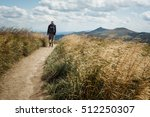 Small photo of BIESZCZADY MOUNTAINS, POLAND AUGUST 2013: A wanderer in Polish Bieszczady mountains. Albeit the tourism, Bieszczady remain one of the genuinely virgin mountains in Poland.