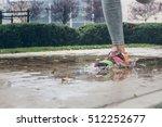 young woman running on asphalt...   Shutterstock . vector #512252677