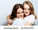 mother and teen daughter... | Shutterstock . vector #512321557